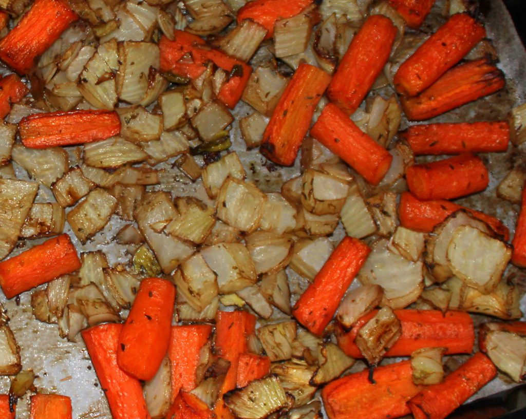 Caramelized oven-roasted vegetables on a baking tray