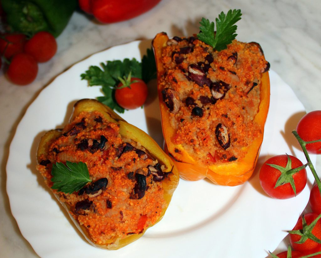 Stuffed bell peppers with couscous and beans on a plate