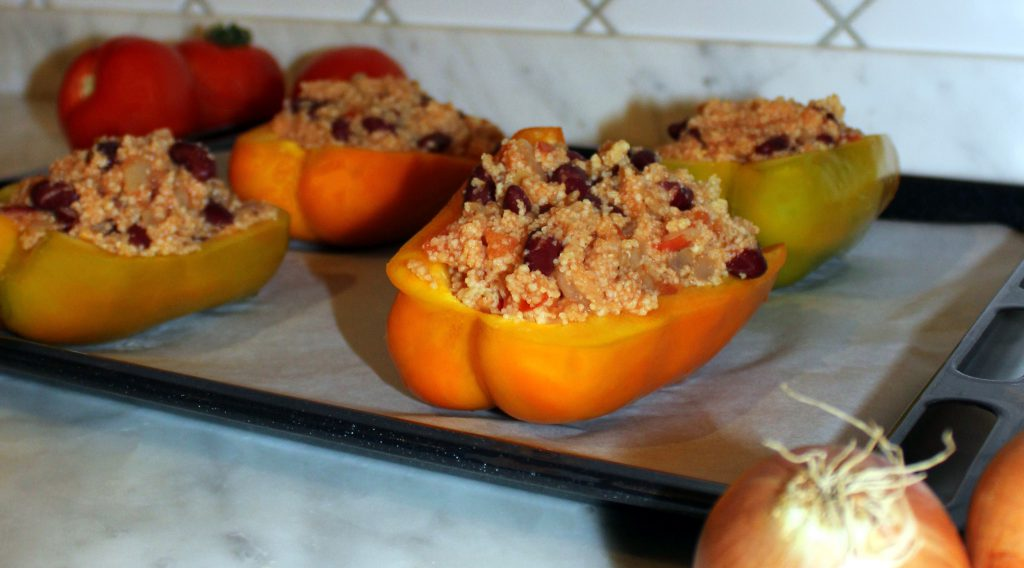 Stuffed bell peppers on a baking tray before baking