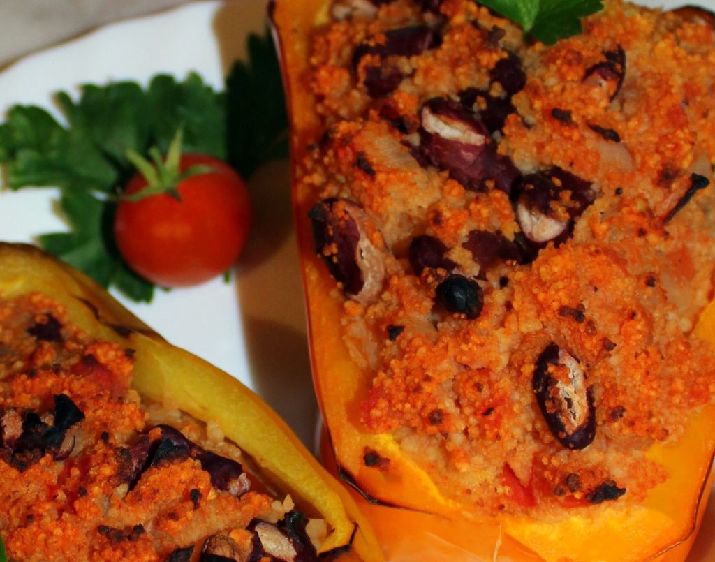 Stuffed bell peppers with couscous and beans in close-up
