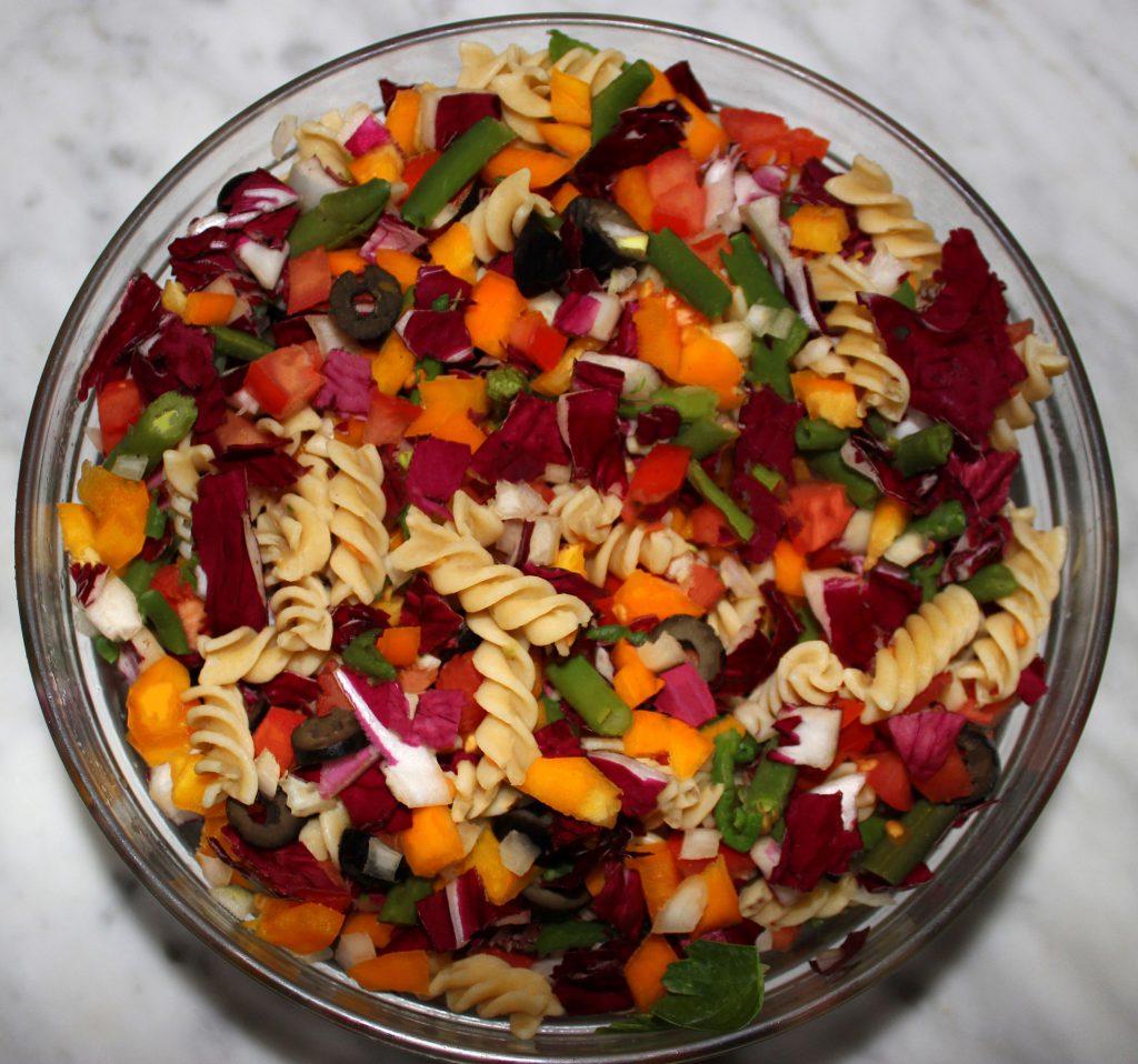 Bowl of rainbow pasta salad