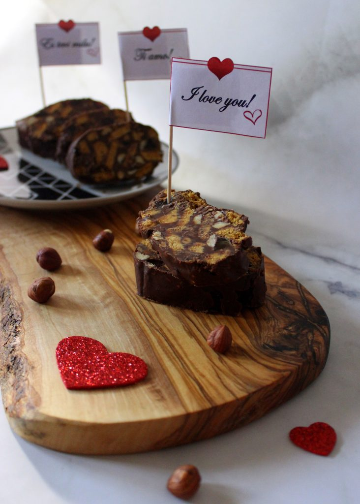 Slices of Vegan No-Bake Chocolate Salami with a sign that says