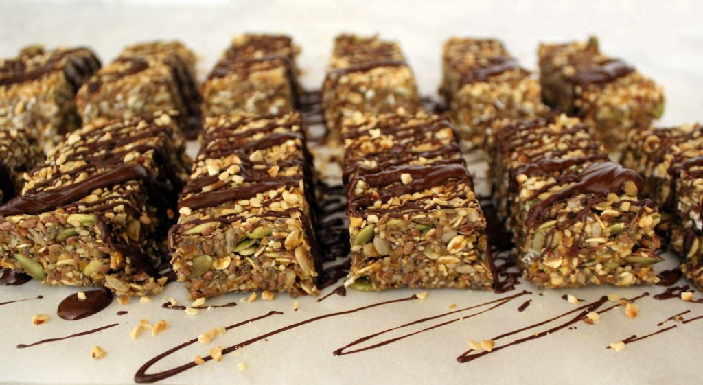 Healthy vegan no-bake protein bars covered with chocolate
