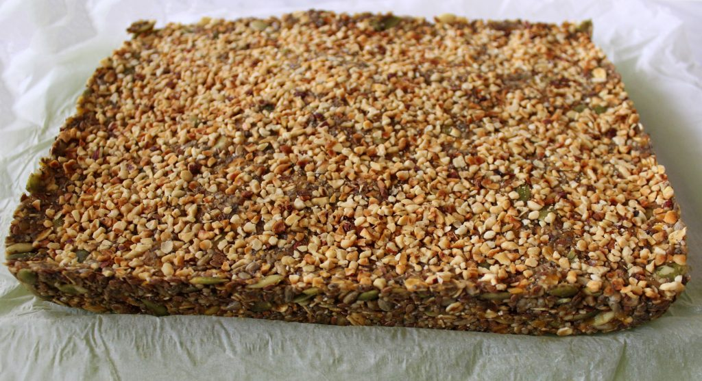 Ready mixture for healthy vegan no-bake protein bars before cutting in bars