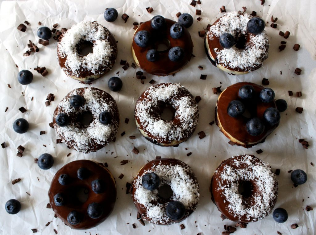 Vegan coconut and blueberry donuts covered with chocolate