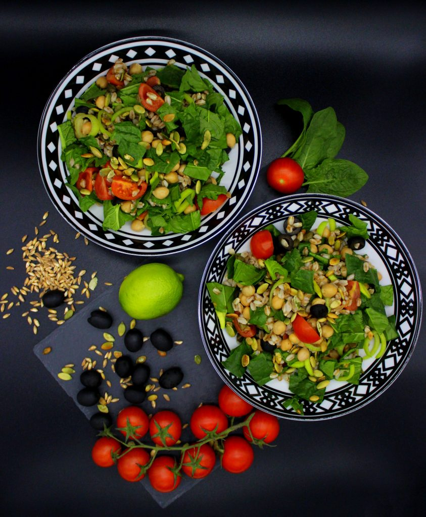 Two plates of farro salad
