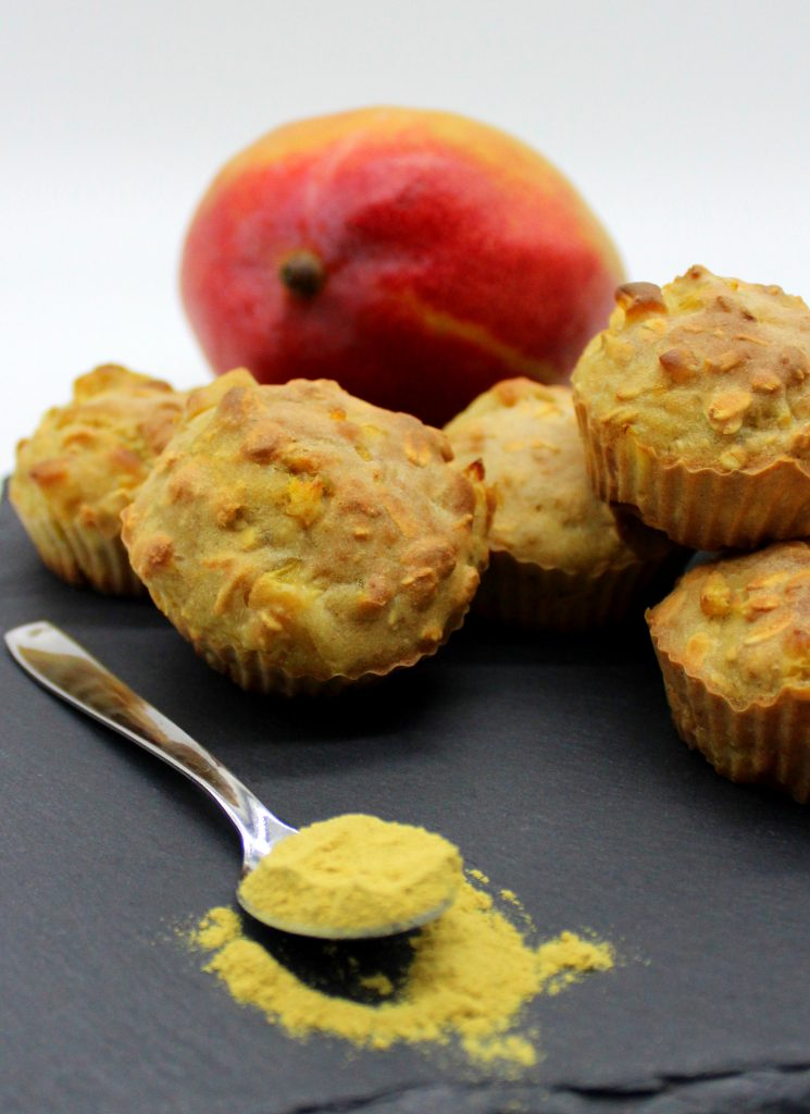 Vegan ginger and mango oatmeal mini muffins and ginger powder in front