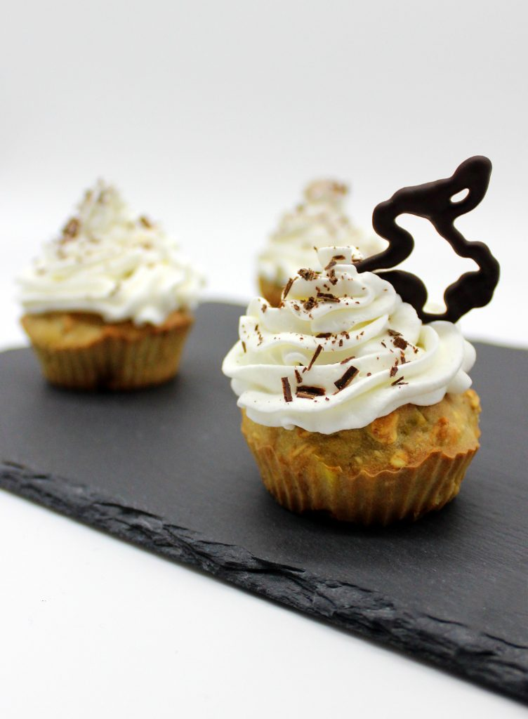 Vegan mini muffins with whipped soy cream and chocolate bunny