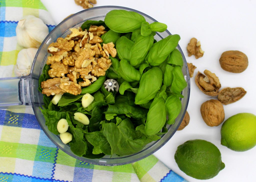 Ingredients for vegan spinacg pesto in a blender