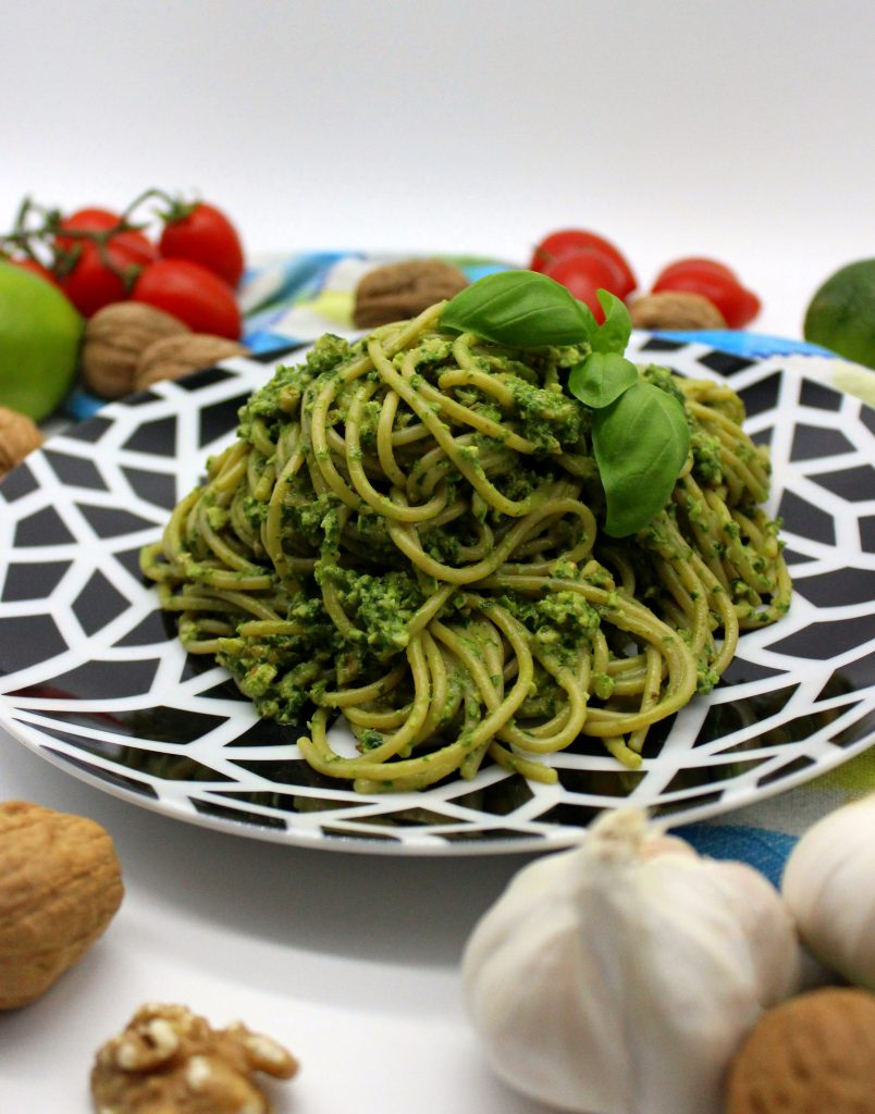 A plate of pasta with spinach pesto