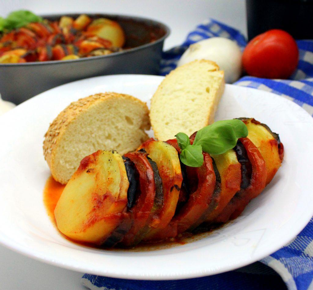 A plate of easy vegan Ratatouille with bread