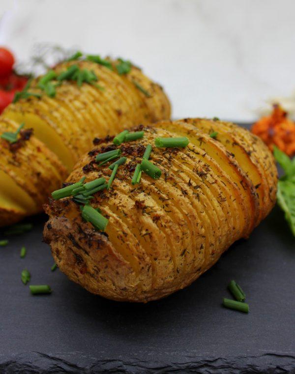 Crispy garlic Hasselback potatoes in closeup