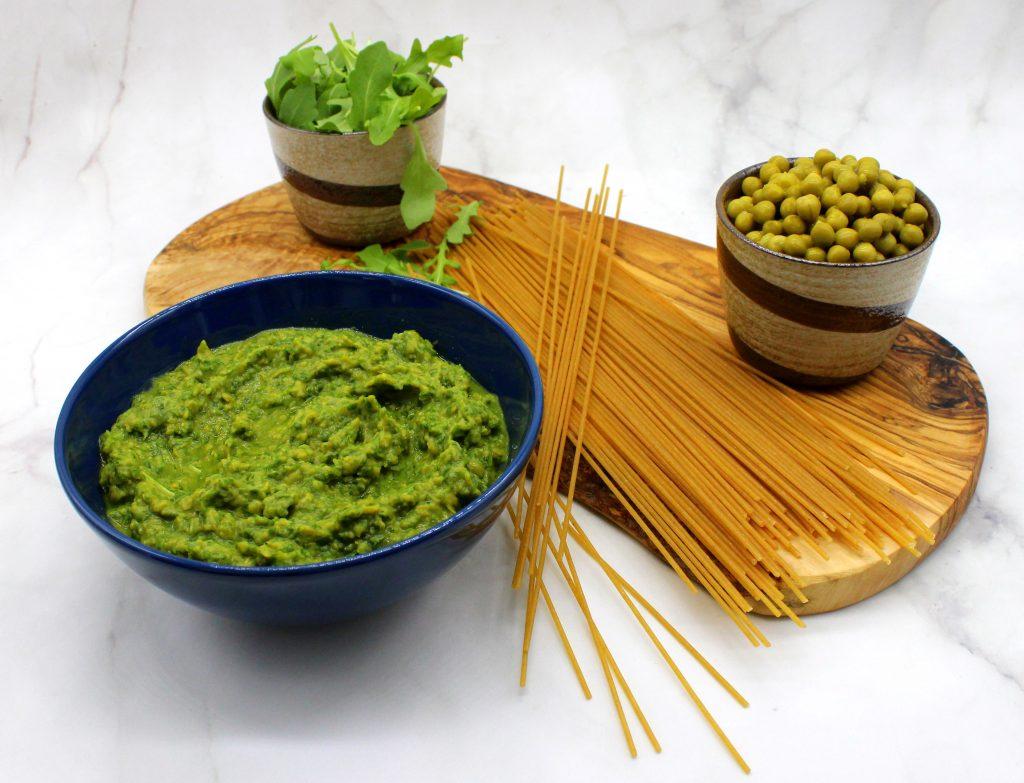 Spaghetti, arugula, green peas and a bowl of green pea and arugula sauce