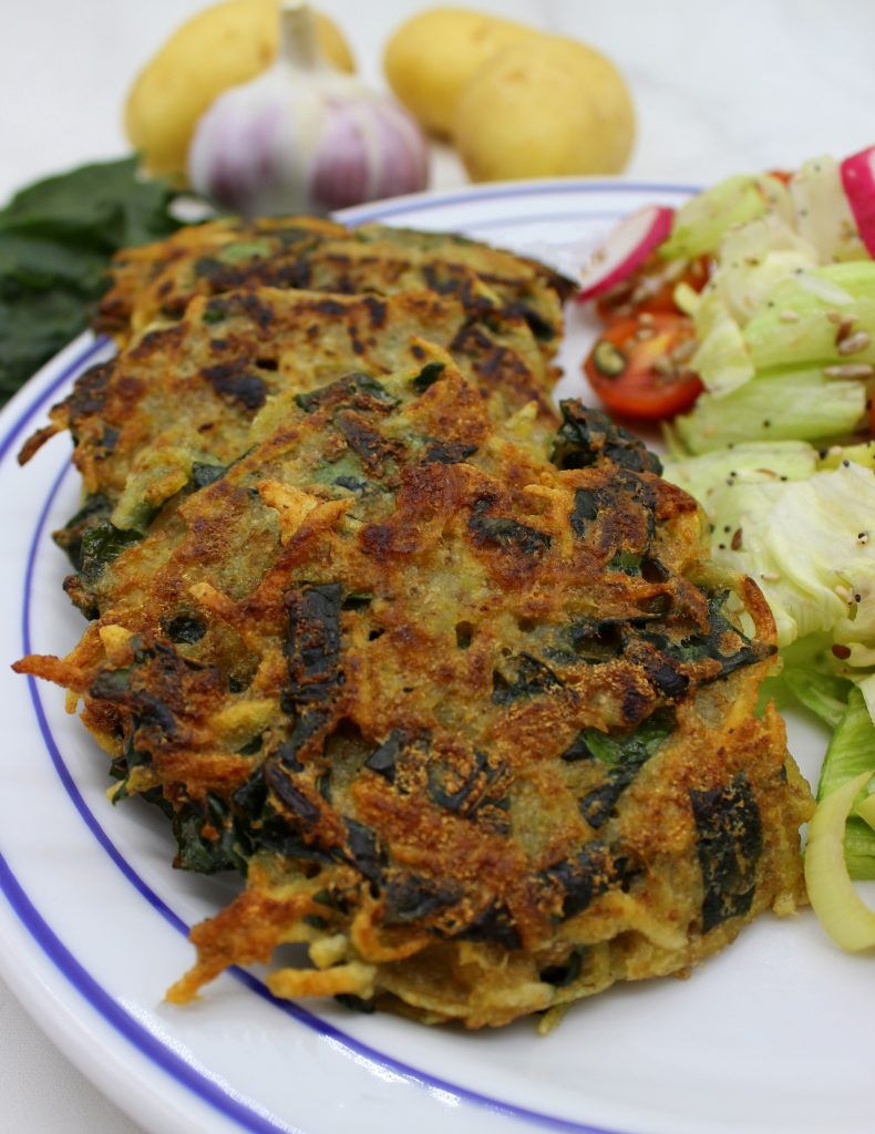 Potato and spinach vegan pancakes in close up