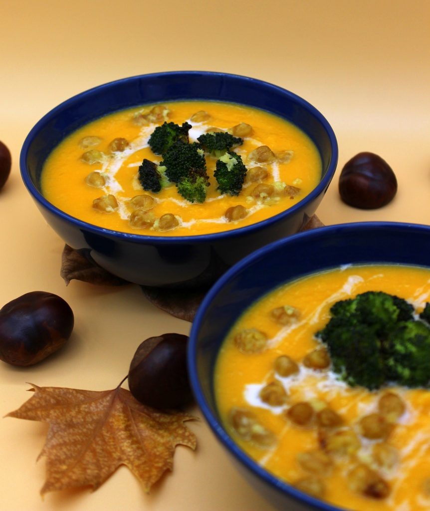 Creamy vegan pumpkin soup with roasted chickpeas and broccoli