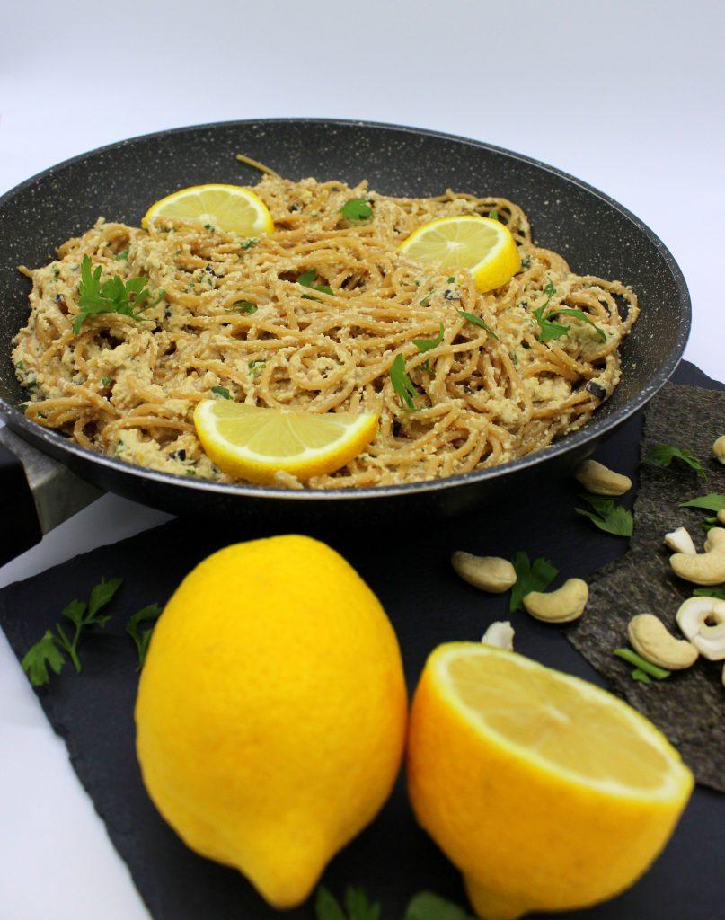 Vegan lemon garlic pasta in a frying pan