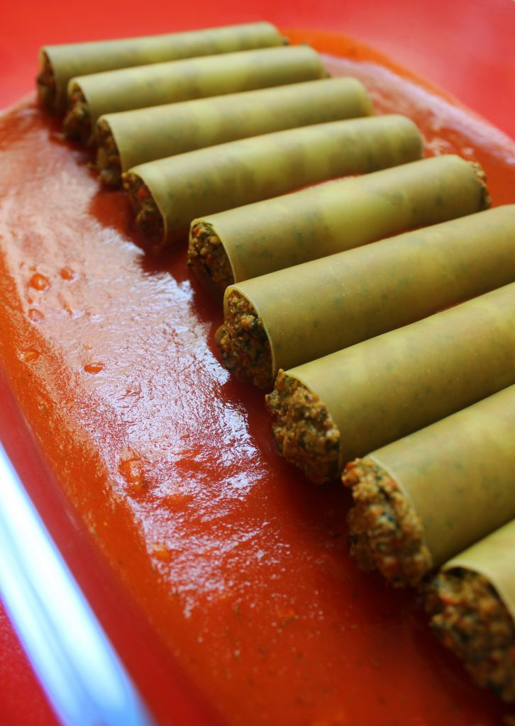 Stuffed vegan cannelloni ready to be cooked
