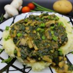 Vegan mashed potatoes with mushroom and spinach gravy