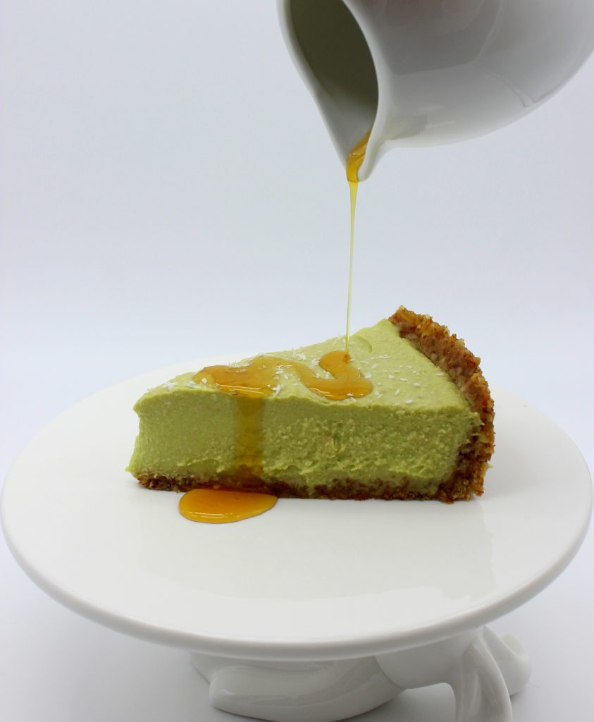Slice of vegan cheesecake with maple syrup