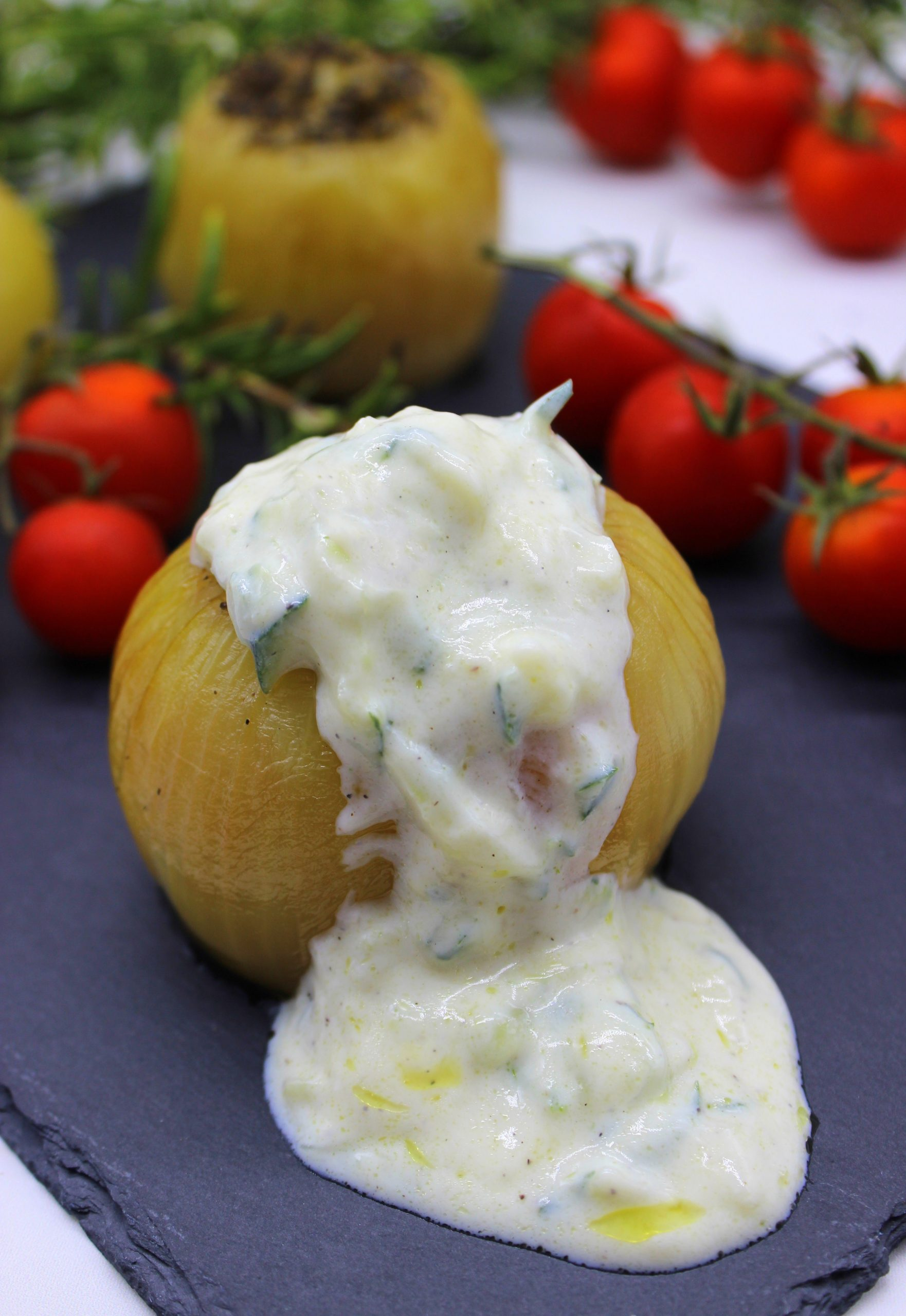 Juicy sweet roasted onions with Tzatziki sauce